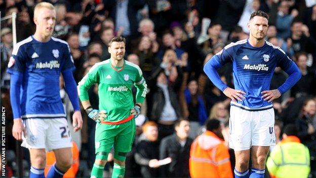 Dejected Cardiff City players following Fulham's late goal