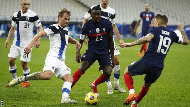 Franc's Lucas Digne and Marcus Thuram, as well as Finland's Rasmus Schuller, in action during the friendly between France and Finland in Paris