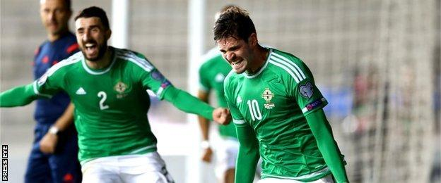 Kyle Lafferty celebrates scoring a crucial last-gasp equaliser against Hungary in September