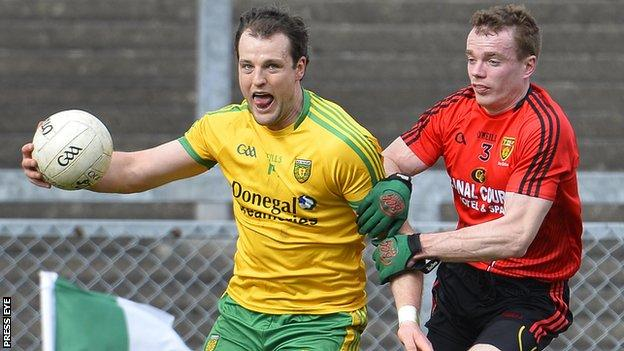 Donegal's Michael Murphy is challenged by Down's Brendan McArdle in the 2014 league encounter