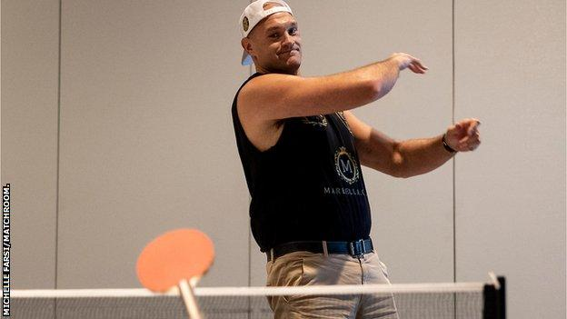 Tyson Fury throws a table tennis paddle