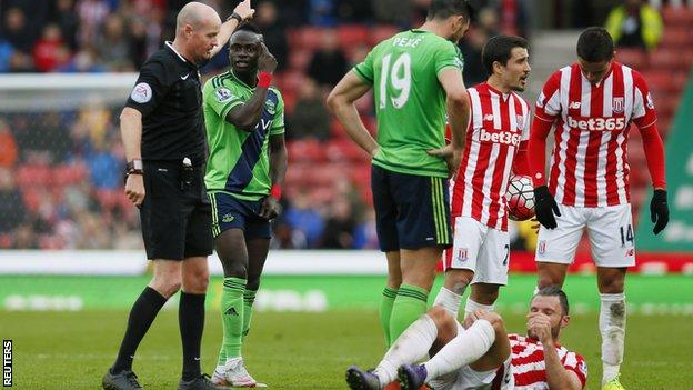 Sadio Mane was sent off after challenging for the ball with Stoke's Erik Pieters (on the ground)