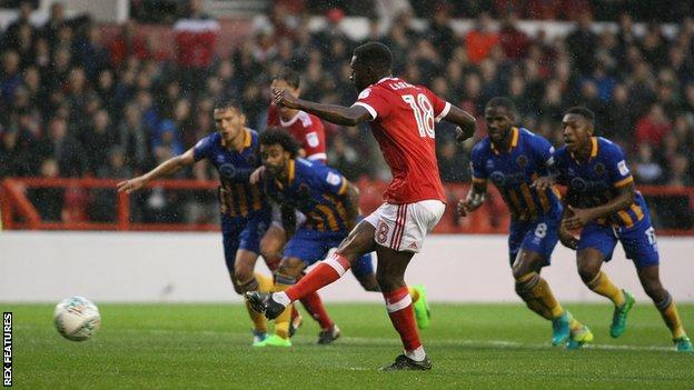 Mustapha Carayol scores from the penalty spot against Shrewsbury