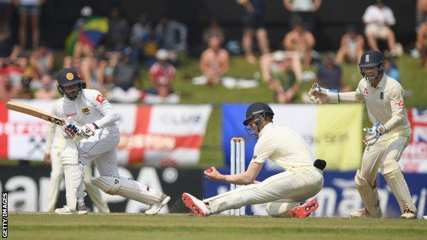 England's Keaton Jennings stays low to take a left-handed catch and dimiss Sri Lanka batsman Dhananjaya de Silva during the second Test
