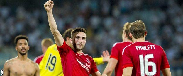 Graeme Shinnie salutes the travelling support