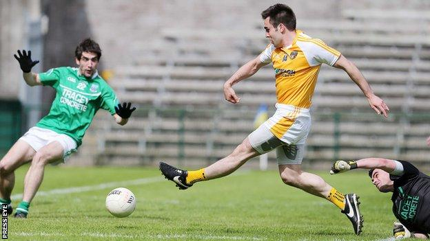 Kevin Niblock strokes in a goal in Antrim's Ulster SFC win over Fermanagh two years ago