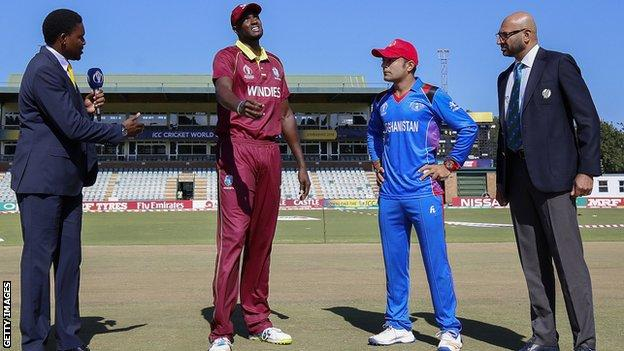 West Indies captain Jason Holder and Afghanistan skipper Asghar Stanikzai