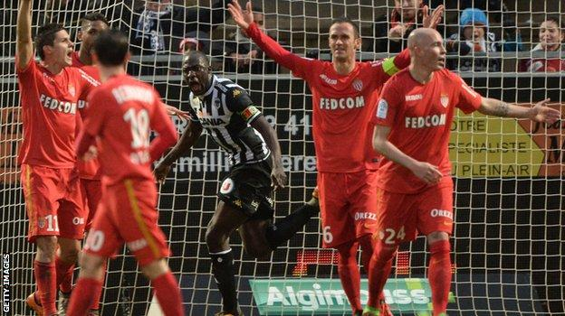 Monaco players protest at a goal from Angers
