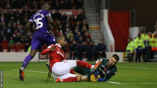 Jack Butland makes a save against Nottingham Forest