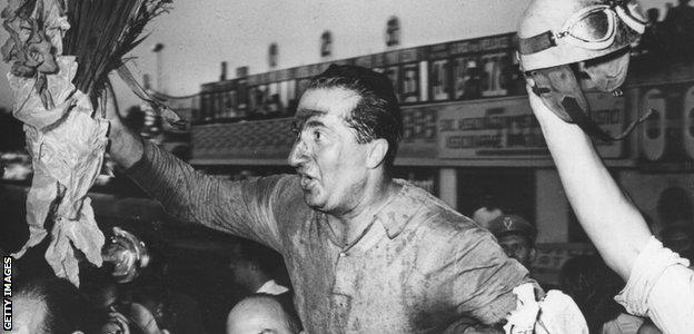 Alberto Ascari celebrates winning the 1951 Italian GP