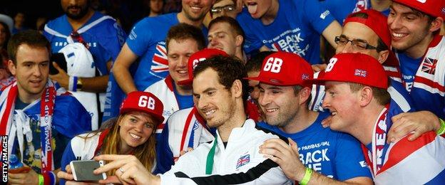 Andy Murray poses with fans after winning the Davis Cup with Great Britain