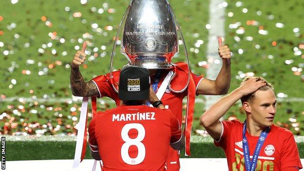 Lucas Hernandez of FC Bayern Munich celebrates with the Champions League trophy following his team's victory in the final