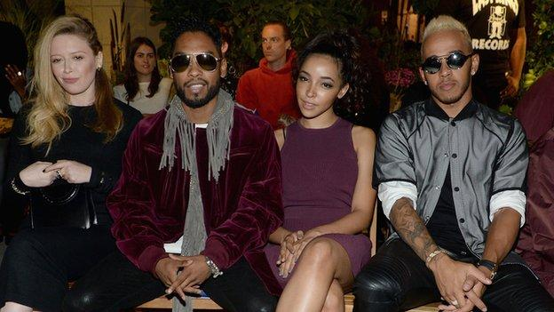 Lewis Hamilton and friends (l-r) actress Natasha Lyonne and musician Miguel