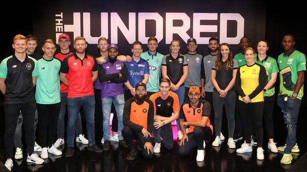 Players including Joe Root, Heather Knight, Ben Stokes and Anya Shrubsole pose in front of The Hundred sign