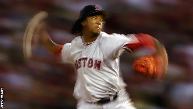 Starting pitcher Pedro Martinez #45 of the Boston Red Sox throws a pitch against the St. Louis Cardinals during the first inning of game three of the World Series on October 26, 2004