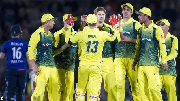 Shane Watson (centre) celebrates a wicket for Australia