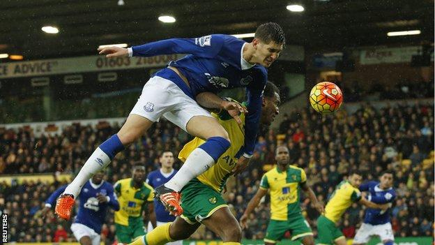Everton defender John Stones in action with Norwich's Andre Wisdom