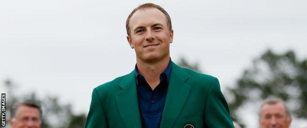 Jordan Spieth with the famous green jacket for winning The Masters