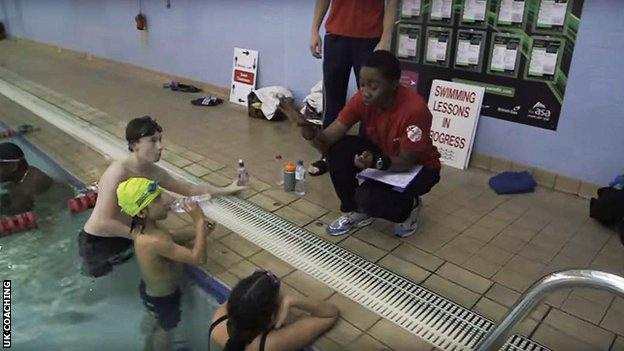 Bisi Imafidon taking a swimming lesson