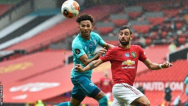 Bournemouth's Lloyd Kelly in action against Manchester United's Bruno Fernandes during a Premier League match at Old Trafford