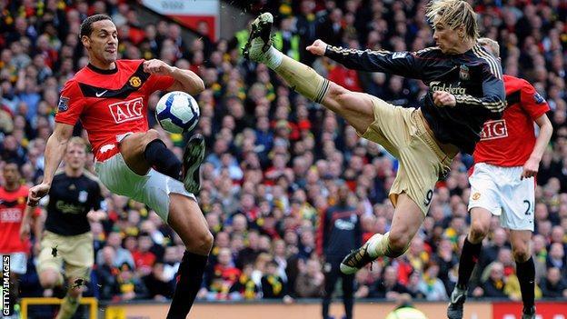 Rio Ferdinand clears from Fernando Torres