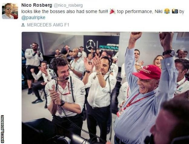 The Mercedes team celebrates after Nico Rosberg's win in Singapore