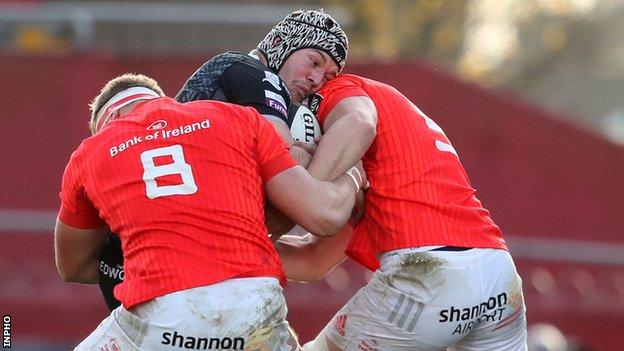 Dan Lydiate is tackled by Gavin Coombes and Fineen Wycherley