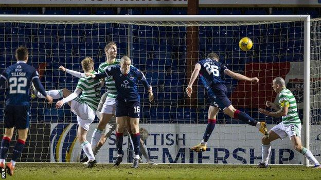 Jordan White (second right) heads the only goal of the game for Ross County