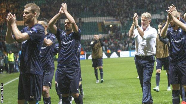 Age Hareide and his Malmo players applaud their fans at the end of the play-off first leg at Celtic Park