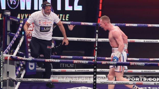 Cheeseman celebrated wildly with trainer Tony Sims after flooring Metcalf