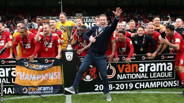 Justin Edinburgh celebrates promotion with Leyton Orient