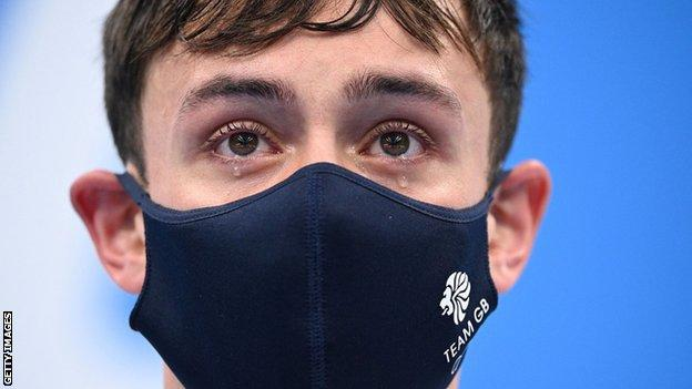 Tom Daley in tears on the podium