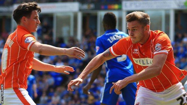 Jacob Blyth (right) celebrates scoring for Blackpool