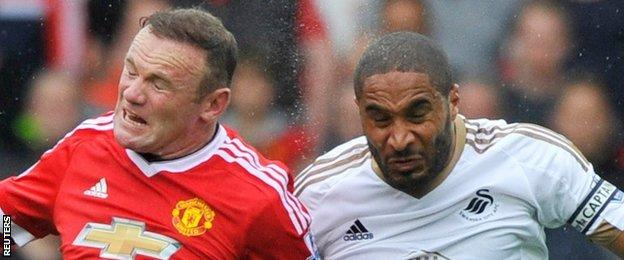 Ashley Williams (right) and Wayne Rooney