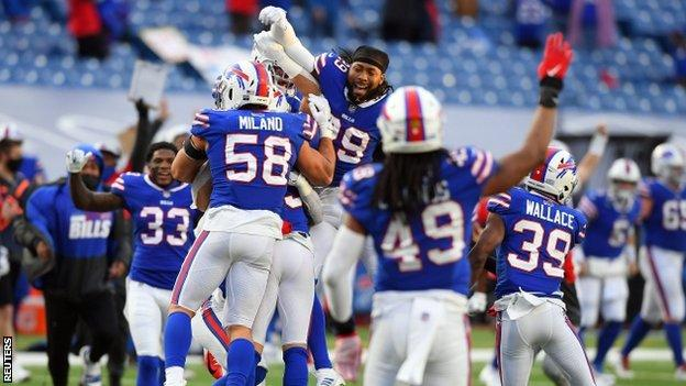 The Buffalo Bills celebrate after their play-off win against the Indianapolis Colts