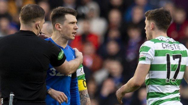 Rangers' Ryan Jack argues with Celtic's Ryan Christie