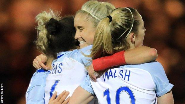Nikita Parris and Keira Walsh celebrate with Steph Houghton