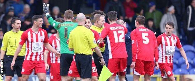 Accrington players appeal with Trevor Kettle