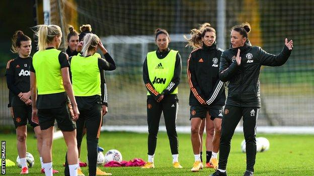 Casey Stoney and the Manchester United team in training