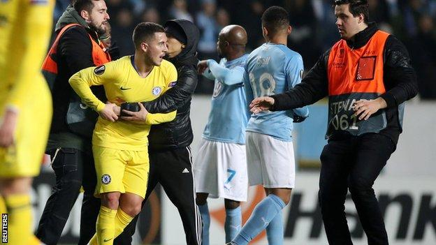 Chelsea charged after fan runs on pitch and hugs Eden Hazard