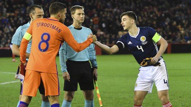 Netherlands captain Kevin Strootman and Scotland captain Kieran Tierney