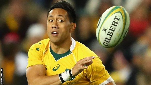 Christian Lealiifano throws a pass during the game against England in Melbourne last year