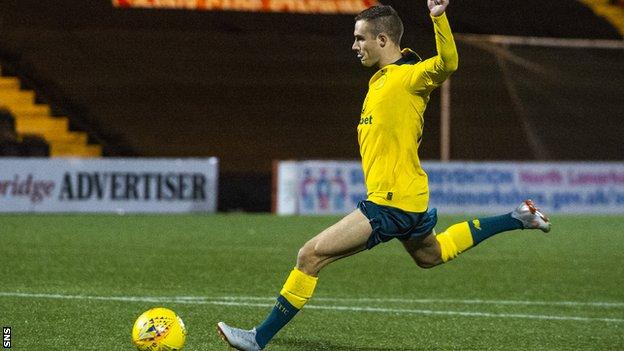 Celtic midfielder Liam Burt scores the winning penalty against Queen's Park