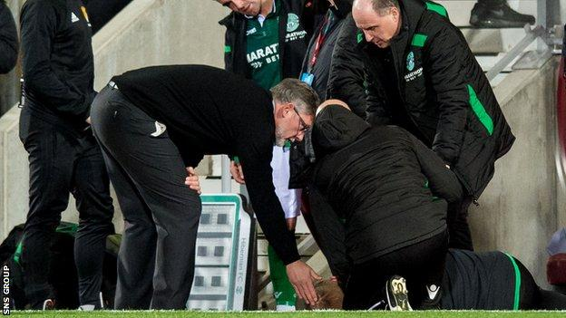 Hibernian manager Neil Lennon was tended to after being struck by a coin in the Edinburgh derby