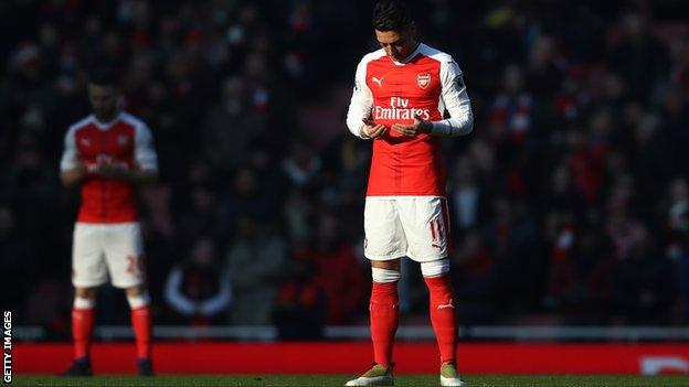 Arsenal's Mesut Ozil (right) prays prior to kick-off during the Premier League match between Arsenal and Burnley