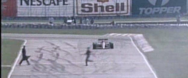 Man runs across the track at the 1989 Brazilian Grand Prix