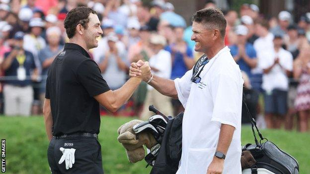 Patrick Cantlay celebrates with his caddie, Matt Minister, on the 18th after winning the Memorial Tournament in 2021