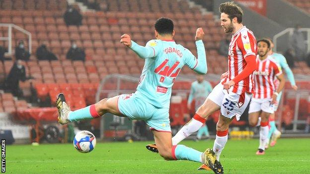 Stoke's leading scorer Nick Powell strokes the ball into the net to put his team in front
