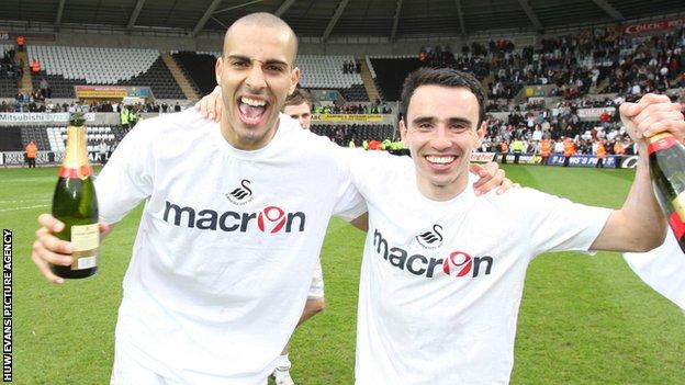 Darren Pratley and Leon Britton celebrate League One promotion to the Championship