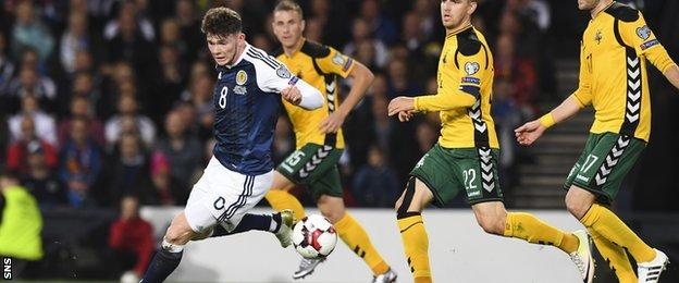 Oliver Burke takes on the Lithuania defence